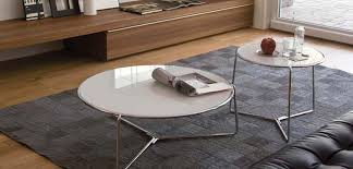 the glass tabletop is available in a variety of colours to match or contrast with your interior these tables look great on their own or cered together