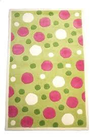 pink polka dot rug and white area