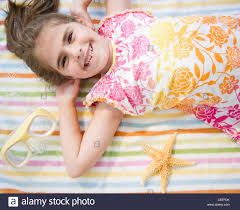 usa new jersey jersey city smiling lying on towel on vacations