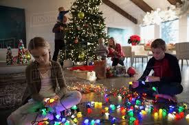 Untangle Christmas Tree Lights Brother And Sister Untangling Christmas Tree String Lights D237_43_362