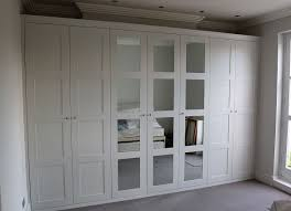 Fitted wardrobe with shaker mirror doors for fitted wardrobes in the loft  room