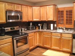 kitchen grey wall paint and brown wooden oak cabinet on laminate flooring plus grey countertop