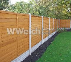 garden fence. Waney Fencing Panels Garden Fence