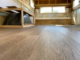 of already spoiled it with the title of this post and the ginormous photo above but after much deliberation we decided to go with vinyl plank flooring