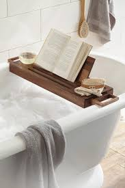 bathtubs out there a bathtub caddy it is designed to hold it all your glass of wine your phone your book your laptop and even a scented candle