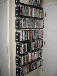 DVD shelves made from VHS tapes - LOL. could make a good book shelf