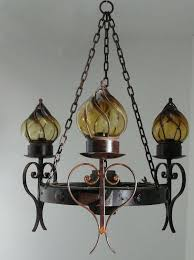punched tin lighting fixtures punched tin chandelier wagon wheel with blown glass globes lamp another