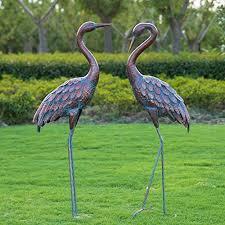 kircust garden crane statues patina