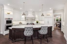 white kitchen with a hardwood flooring the curved center island boasts a very smooth and