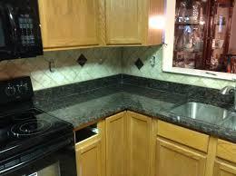 donna s tan brown granite kitchen countertop w travertine backsplash granix