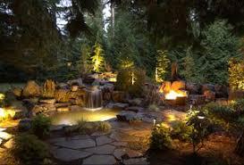 hinkley landscape lighting. rustic landscape/yard with pond, exterior stone floors, hinkley lighting 1502 led path landscape