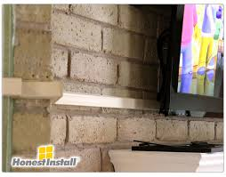 tv on brick fireplace hiding wires ideas
