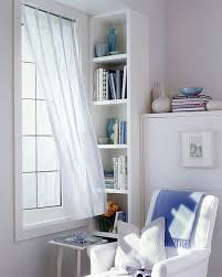 reading corner for two with a bookcase room divider view