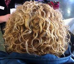 blonde thick permed short hairstyle