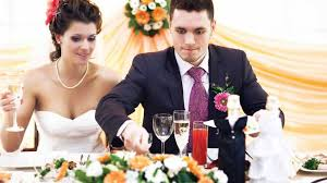 husband and wife eating at wedding