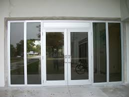 fixed front door design with thick aluminum framing and dark glass screen for medium sized