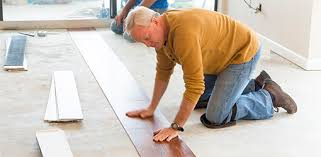 danny lipford lays vinyl plank flooring in the beachfront condo