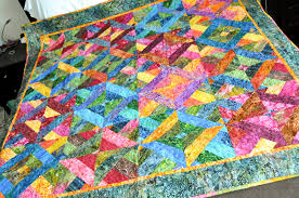 Jelly Roll Batiks Quilt | A Jelly Roll Jumble Quilt with the… | Flickr & ... Jelly Roll Batiks Quilt | by Tricia Curtis Adamdwight.com