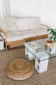 Create a large 48x48 block style concrete coffee table, but not weighing 1000lbs of solid concrete, and also not be expensive. Diy 100 Glass And Concrete Coffee Table Remodelista