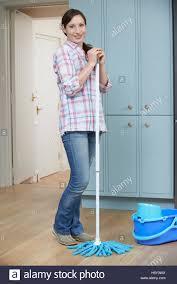 Kitchen Floor Mops Portrait Of Woman Cleaning Kitchen Floor With Mop Stock Photo