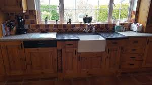 pine effect kitchen including belfast sink and granite surround open to offers