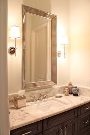 tip 2 hang wall mirrors at the perfect height a wall mirror should be placed at the right height so people won t need to stoop because the mirror is too