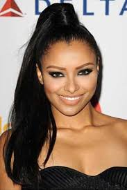 kat graham s high ponytail with hair wrapped around the band
