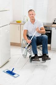 Kitchen Floor Mop Disabled Man On Wheelchair Cleaning Floor With Mop In Kitchen