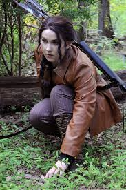 writer for misfits a book blog top ten tuesday books and  sport a leather jacket or a hunting jacket some black jeans braid your hair to the side and put on some barely there make up and you got yourself katniss