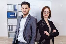 Serious Successful Business Team Of A Young Man And Woman Posing