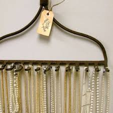 A rake! it's the perfect inventive way to display long necklaces. Post has  many