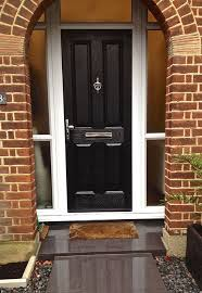 4 panel posite front door in black brown with side light and top lights all around