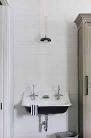 white vintage sink on shiplap wall