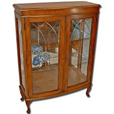 a beautiful antique carved oak glass front bookcase or display cabinet the bookcase features solid oak construction with nice wood grain and
