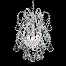 a chandelier with swarovski crystal features
