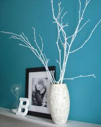 Painted branches in a vase. DIY so pretty and what a fun and cheap  decoration! Sticks can be spray painted any color to match your decor!