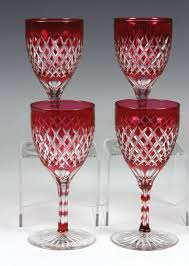 beautiful set of four late 19th century cranberry cut to clear wine glasses