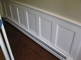 environmentally friendly hydronic baseboard heaters white paint wainscoting with dark hardwood floor also hydronic baseboard