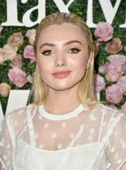 peyton list topped off her look with a s back hairstyle when she attended the