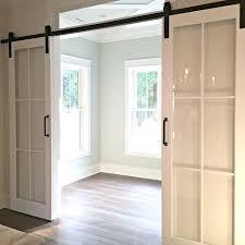 a crisp alternative to barn doors im liking this look a paint glass barn door glass glass sliding doors