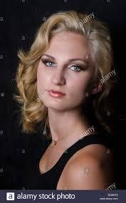 dramatic studio lighting. a beauty model poses fiercely in dramatic studio lighting with marilyn monroe inspired hair