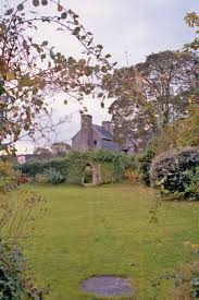 garden at landmark trust property monkton old hall in pembroke pembrokeshire wales uk photograph by l