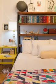 view in gallery place a bookshelf behind a bed instead of a headboard