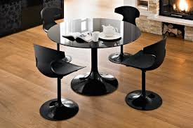 furniture round black glass dining table with round base added by four black dining chairs