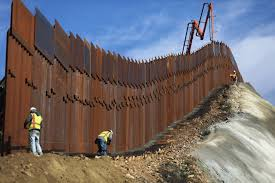 a construction crew works to install new sections of the u s mexico border barrier replacing smaller fences in january mario tama getty images