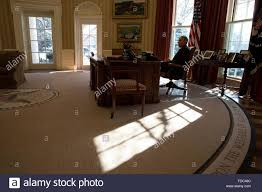 oval office july 2015. U.S. President Barack Obama Sits At The Resolute Desk As Sun Streams Into Oval Office July 2015 E