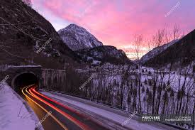 Valley Of Lights In Italy Car Trail Lights On Icy Road At Dawn Campodolcino Spluga