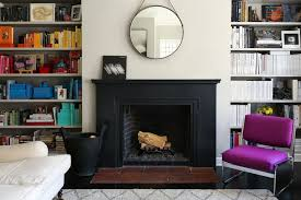 bookshelves flanking a fireplace in lauren goodman s home