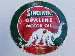sinclair opaline motor oil porcelain sign gas station vine dinosaur dino farm