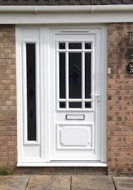 front door and side panel in white upvc door has a glass panel with a